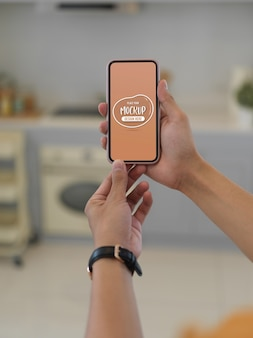 Close up view of hands holding mockup smartphone