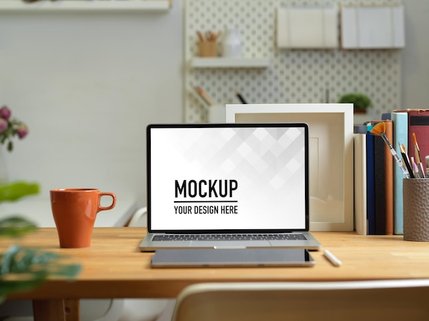 Close up view of home office desk with laptop mockup
