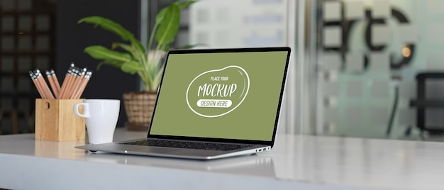 Close up view of laptop mockup in office