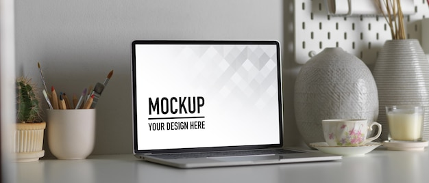 Close up view of laptop mockup, stationery and decorations