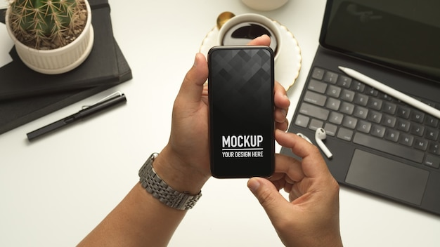 Close up view of male hands holding smartphone mockup