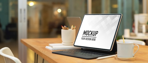 Close up view of mockup laptop with coffee cup