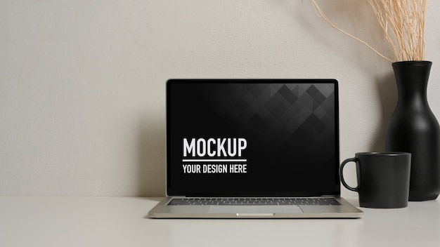 Close up view of mockup laptop with vase