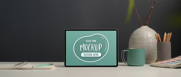 Close up view of office table with mockup tablet