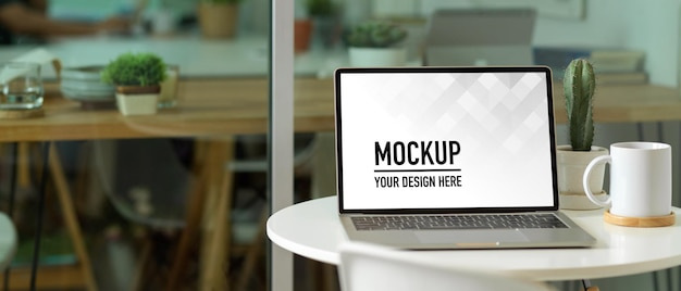 Close up view of portable workspace with laptop mockup