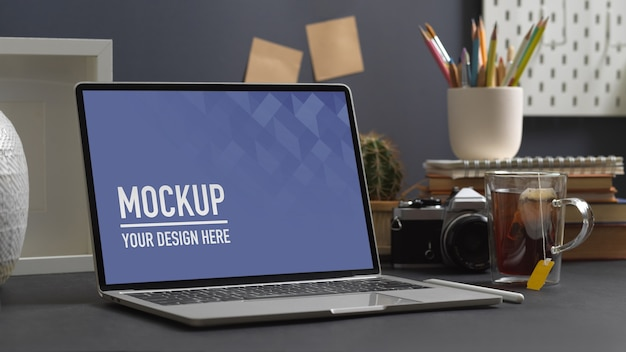 Close up view of workspace with laptop mockup in home office room