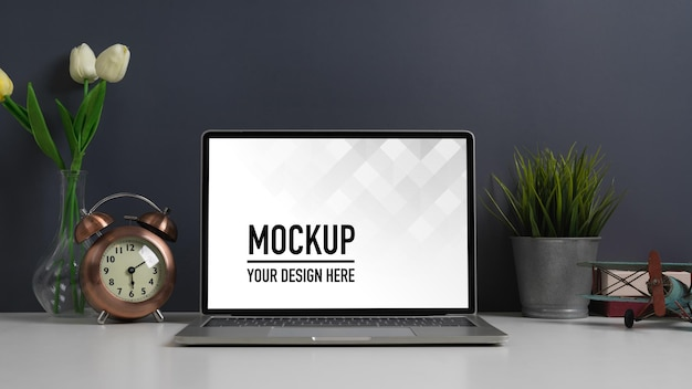 Close up view of worktable with laptop mockup Premium Psd