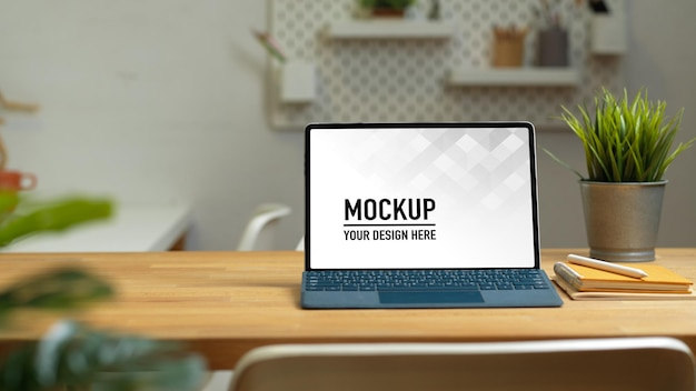 Close up view of worktable with laptop mockup