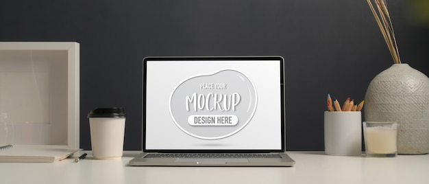 Close up view of worktable with mockup laptop