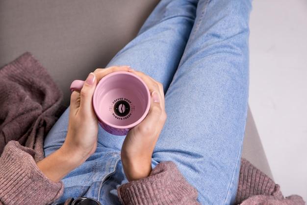 Close-up woman holding mug top view