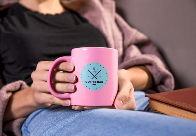 Close-up woman holding pink mug