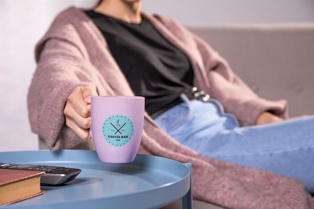 Close-up woman with pink mug