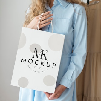 Close-up woman with shopping bag mockup