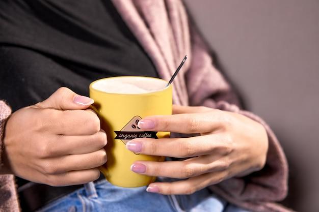 Close-up woman with yellow mug