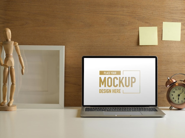 Close up of workspace with laptop mockup and decorations in home office room
