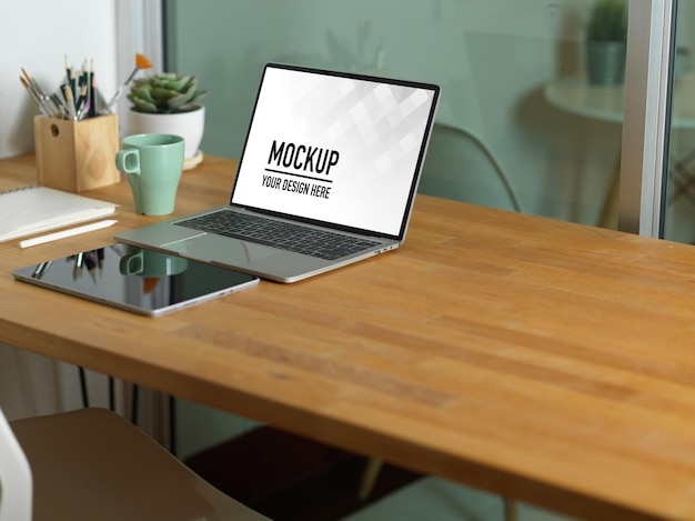 Close up on workspace with laptop mockup