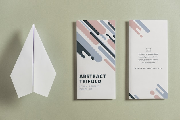 Closed trifold brochure mockup with paper plane