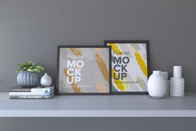 Closeup of a black frame with vases and books on a gray wall background frame mockup