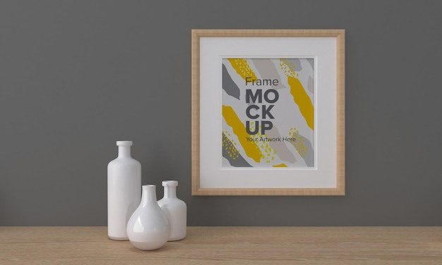 Closeup of a frame mockup  next to vases on a gray wall background