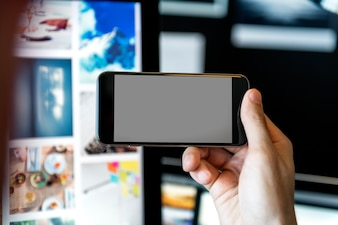 Closeup of an empty screened smartphone turned sideways