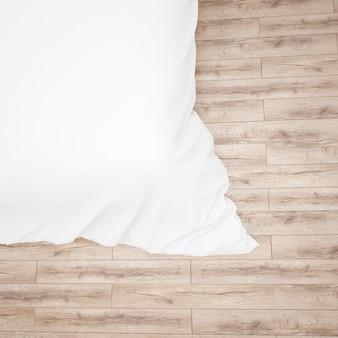 白いベッドの掛け布団またはキルトのクローズアップ