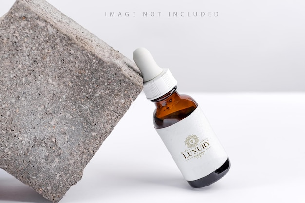 Closeup serum essence in glass mockup bottle on stand background isolated skincare oil