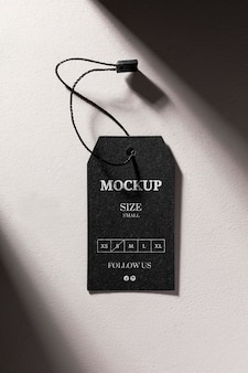 Clothing black size tag mock-up with shadows