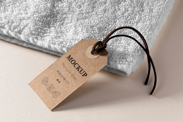 Clothing mock-up tag with thread on towel