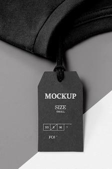Mock-up nero taglia abbigliamento e asciugamano nero