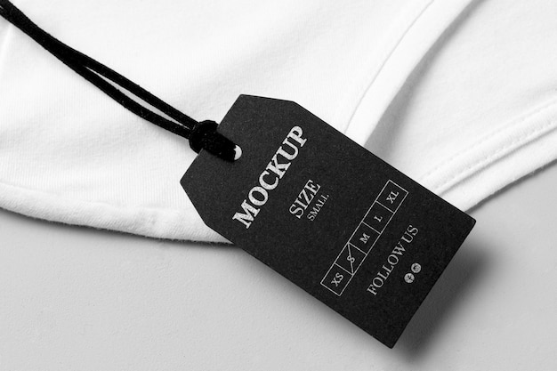 Clothing size black mock-up high view and white towel