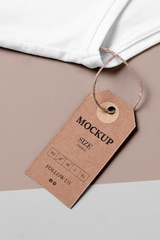 clothing size cardboard mock-up high view and white towel