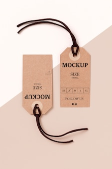 Clothing size tag mock-up on white and pink background