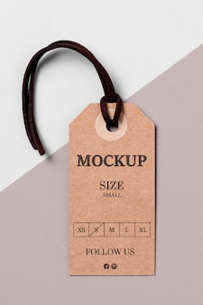 Clothing size tag mock-up with black thread