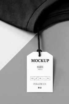Clothing size white mock-up and black towel