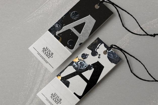 Бирки одежды мраморный мокап psd в черном цвете для модных брендов diy экспериментальное искусство