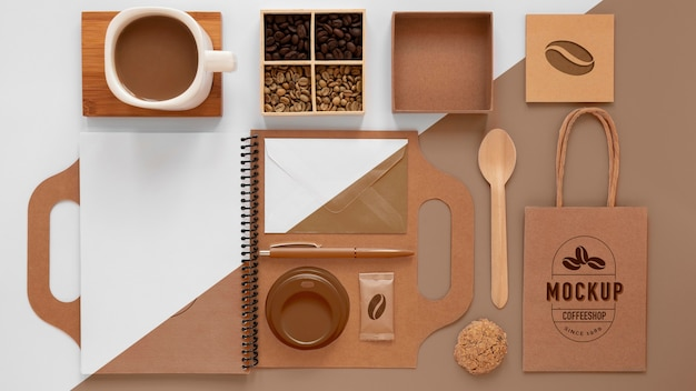Coffee beans and branding items flat lay