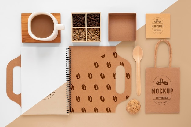 Coffee beans and branding items top view