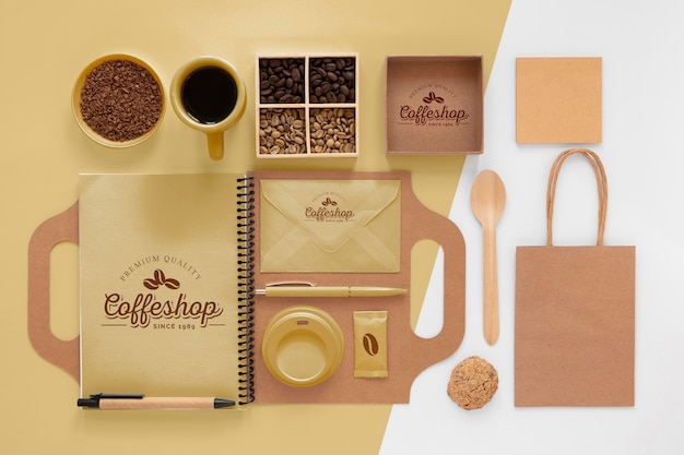 Coffee beans and branding items above view