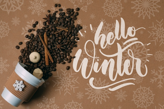 Coffee beans in a cup with hello winter greeting