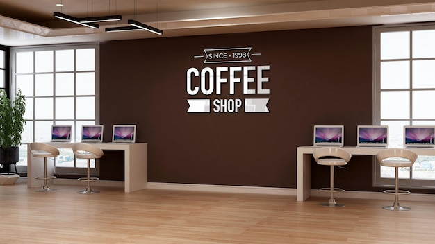 Coffee shop logo mockup in cafe wall signage with laptop desk with workspace theme