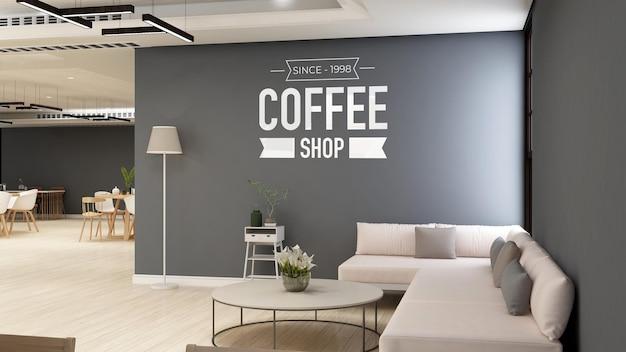 ソファ付きのモダンなカフェルームでブランディングするためのコーヒーショップまたはカフェの壁のロゴのモックアップ