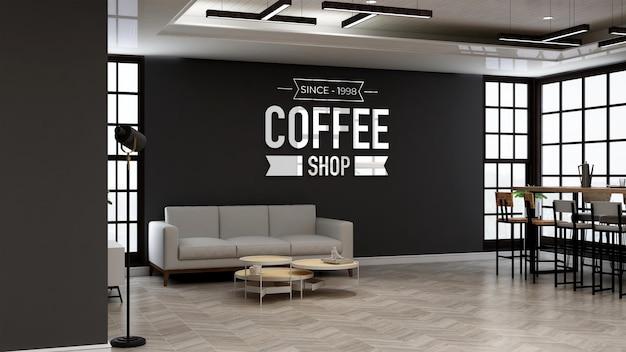 소파가 있는 현대적인 카페 룸에서 브랜딩을 위한 커피숍 또는 카페 벽 로고 모형 프리미엄 PSD 파일