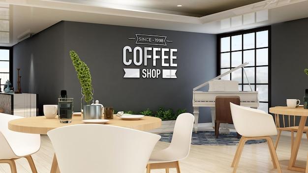 Макет логотипа кофейни в современном кафе или ресторане