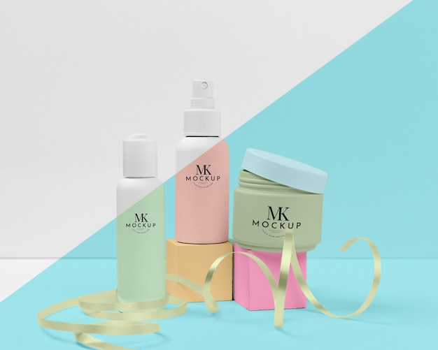 Collection of mock-up beauty products with ribbon