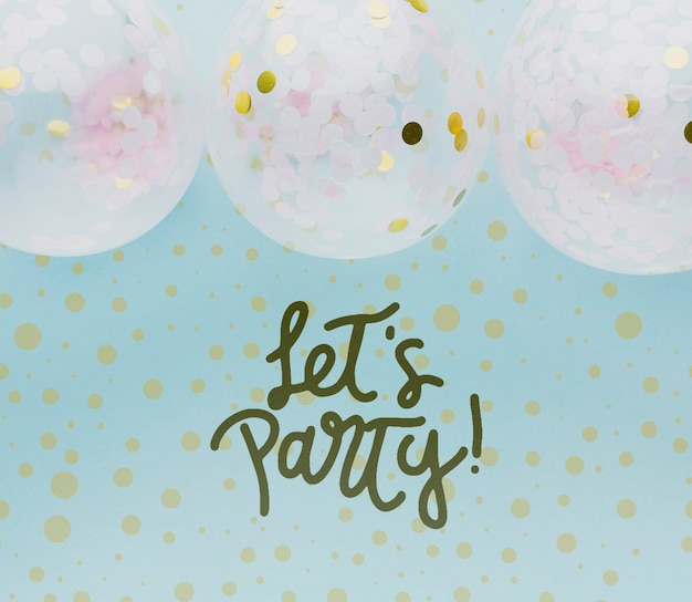Colorful balloons with confetti and lettering