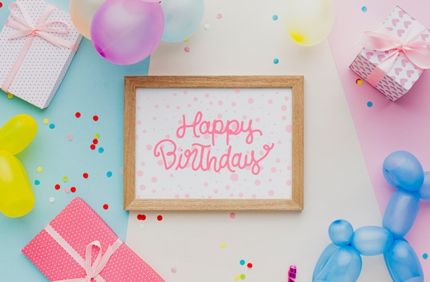 Colorful birthday balloons with confetti