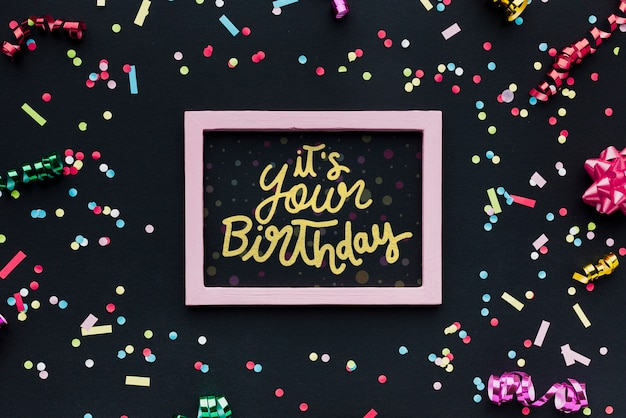 Colorful birthday lettering with confetti