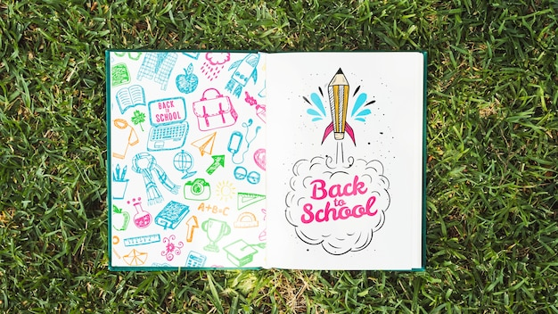 Colorful book on grass mock-up