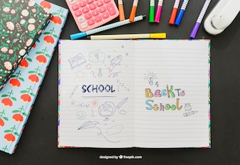 Colorful drawing on the notebook with school material