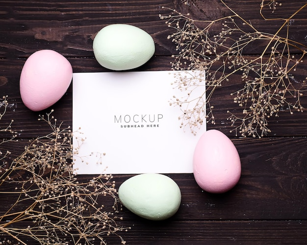 Colorful easter eggs and flowers on paper mockup